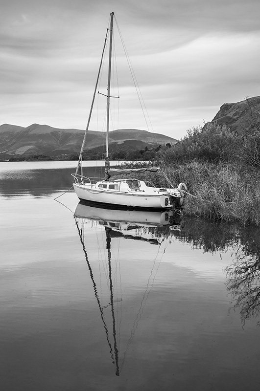 A sailing boat moored up on Derwent Water UK