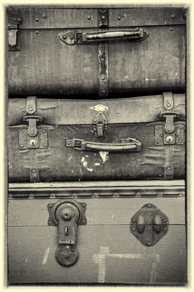 Three old suit cases.