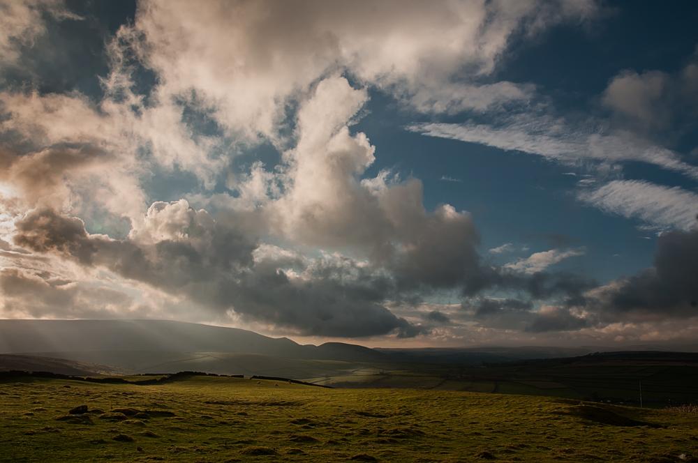 Sunbeams breaking through the clouds.