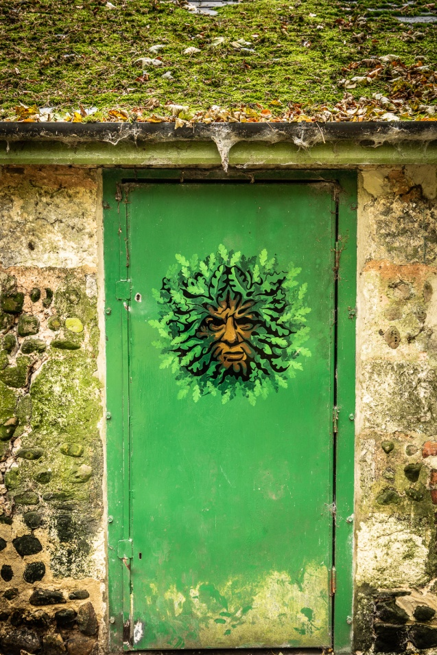 A painted green man